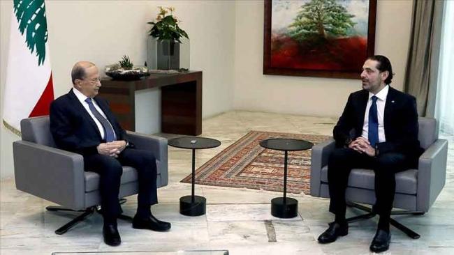 Lübnan Cumhurbaşkanı Mişel Avn (solda) ile hükümet kurma görevini üstlenen Saad Hariri (sağda). Fotoğrf: AA