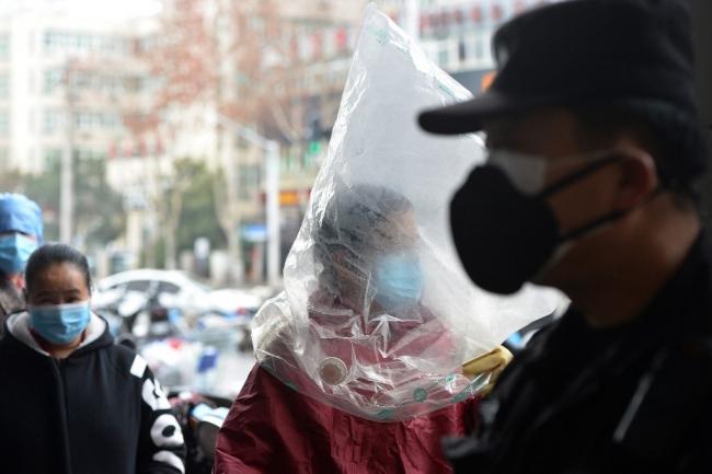 Çin'de vatandaşlar koronavirüse karşı kişisel tedbirlerini almakla yükümlü. | Fotoğraf: AFP
