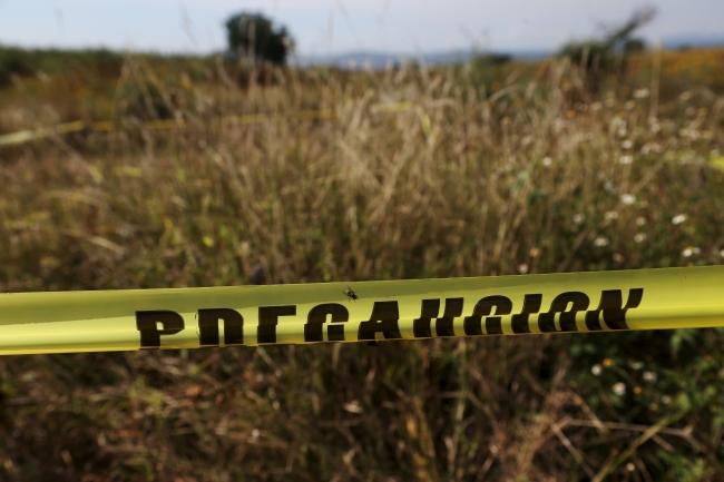 Uyuşturucu karteli şiddetinin özellikle son 10 yılda arttığı Meksika'da zaman zaman kurbanların gömüldüğü toplu mezarlar da bulunuyor. Fotoğraf: Reuters, Kasım 2015